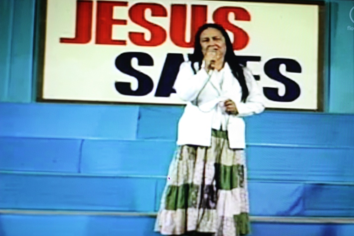 Sis. Victoria dela Cruz testifying in the pulpit; Friday overnight worship service, March 2013 at Amoranto Stadium.
