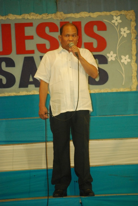 Beloved Captain Ferdinand Estillore testifying in the pulpit during Friday Overnight Worship Service at Amoranto Stadium, Quezon City, Sept. 2013.